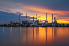 Oil refinery. With sunrise background Royalty Free Stock Photo