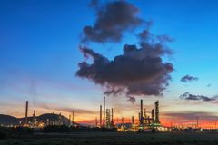 Oil refinery at sunrise sky. Stock Image