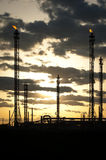 Oil refinery at sunset Stock Photography