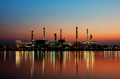 Oil refinery at sunset. Petrochemical plant - factory at Bangkok Thailand Royalty Free Stock Photos