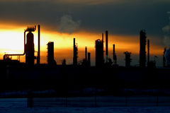 Oil refinery at sunset. In Edmonton, Alberta, Canada royalty free stock photo