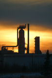 Oil refinery at sunset. Scenic view of silhouetted towers in oil refinery at sunset, Edmonton, Alberta, Canada royalty free stock images