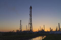 An oil refinery at sunset Stock Photo