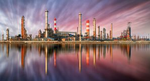 Oil Refinery at sunset with reflection Royalty Free Stock Photography