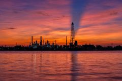 Oil refinery and surrounding communities at twilight. Chao Phraya river, Thailand Stock Photo