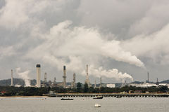 Oil refinery in Sydney, Australia. Smoke and steam billows from oil refinery chimney stacks Stock Images