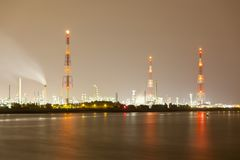 Refinery And Flare Stack At Night Stock Images