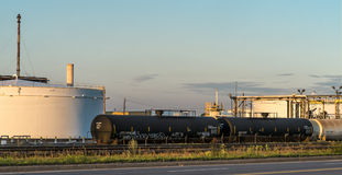 Oil Refinery tank  and  train liquid cars. The Montreal oil  refinery at sunset Stock Image