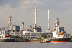 Oil refinery and tanker ship on port in heavy industry use for e Stock Photos