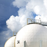 Oil refinery tanks. Over blue sky Stock Images