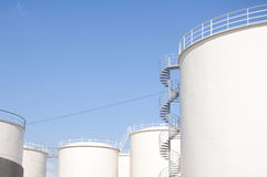 Oil refinery tanks. With blue sky background Royalty Free Stock Photo