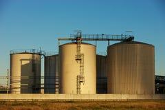 Oil refinery tanks. Late sunlightlight over an oil tanks Royalty Free Stock Image