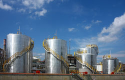 Oil refinery with tanks. Oil refinery with metal tanks Royalty Free Stock Photo