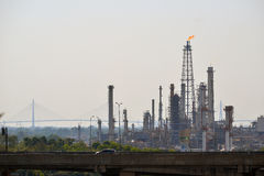 Oil refinery tower with exhausted flame Royalty Free Stock Photo
