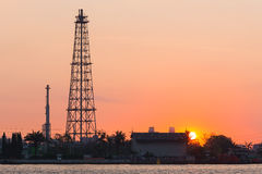 Oil refinery tower during sunrise Royalty Free Stock Image