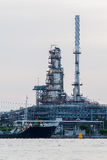 Oil refinery tower and tank river front Royalty Free Stock Photos