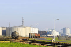 Oil  refinery  with train fuel tankers Royalty Free Stock Images