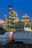 Oil Refinery And Trains At Night Stock Photo