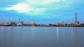 Oil Refinery At Twilight along the river Royalty Free Stock Photo