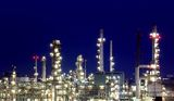 Oil refinery at twilight Stock Photos