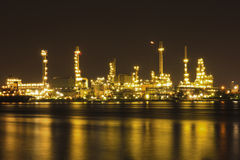 Oil refinery at twilight Bangkok Thailand Stock Photos
