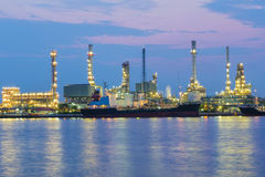Oil refinery at twilight with river front Royalty Free Stock Images