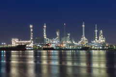 Oil refinery at twilight with river reflexion Royalty Free Stock Photo