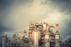 Oil refinery under cloudy sky in Pasadena, Texas, USA. Oil refinery, oil factory, petrochemical plant in Pasadena, Texas, USA under cloudy sky. Vintage tone Royalty Free Stock Photography