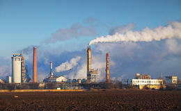 Oil refinery with vapor - petrochemical industry Royalty Free Stock Photography