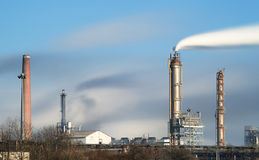 Oil refinery with vapor - petrochemical industry Royalty Free Stock Photos