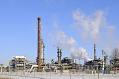 Oil refinery in winter landscape Royalty Free Stock Image