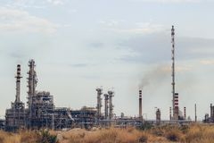 Free Oil Refinery With Visible Smoke Coming Out Of Chimneys; Pollution Concept, With Copy Space Royalty Free Stock Images - 158158149
