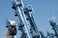 Oil refinery and worker Royalty Free Stock Photos