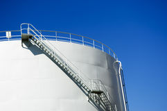 Oil reservoir. Detail with acess ladder against a blue sky Royalty Free Stock Photos