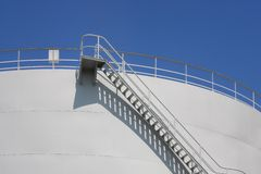 Oil reservoir detail with access ladder against Royalty Free Stock Image