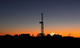 Oil rig. Onshore oil rig in the sunset royalty free stock photography