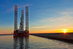 Oil rig. At sunset background royalty free stock images
