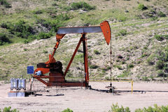 Oil Rig. Sitting in the middle of the prairie stock images