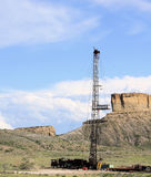 Oil Rig. Towering high in sky with rock formation in the background royalty free stock photos