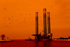 Oil rig. At sunset background stock photo