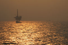 Oil rig. With setting sun of the coast of Florida, USA stock image
