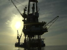 Oil rig against the sun - Petrochemical industry - Business Industries stock video footage
