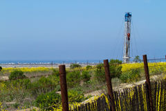 Oil Rig Behind A Rusty Fence Royalty Free Stock Photos