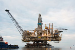 Oil rig being tugged. In the sea Stock Images