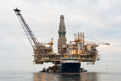 Oil rig being tugged. In the sea Royalty Free Stock Image