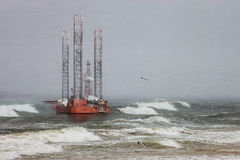 Oil rig in blizzard. Oil rig in a winter storm day during a violent blizzard Stock Photo