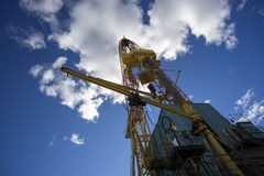Oil rig on blue sky background Royalty Free Stock Images