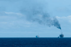 Oil rig burning gas Stock Images