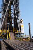 Oil rig and casing on the cantilever deck. Jack Up Offshore Drilling Rig With Casing Laying On The Cantilever Deck stock photo