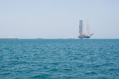 Oil rig drilling platform in large Pacific Ocean Stock Image
